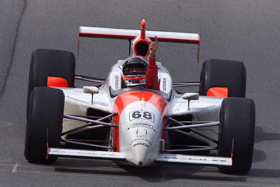 2001: Helio Castroneves salutes his victory