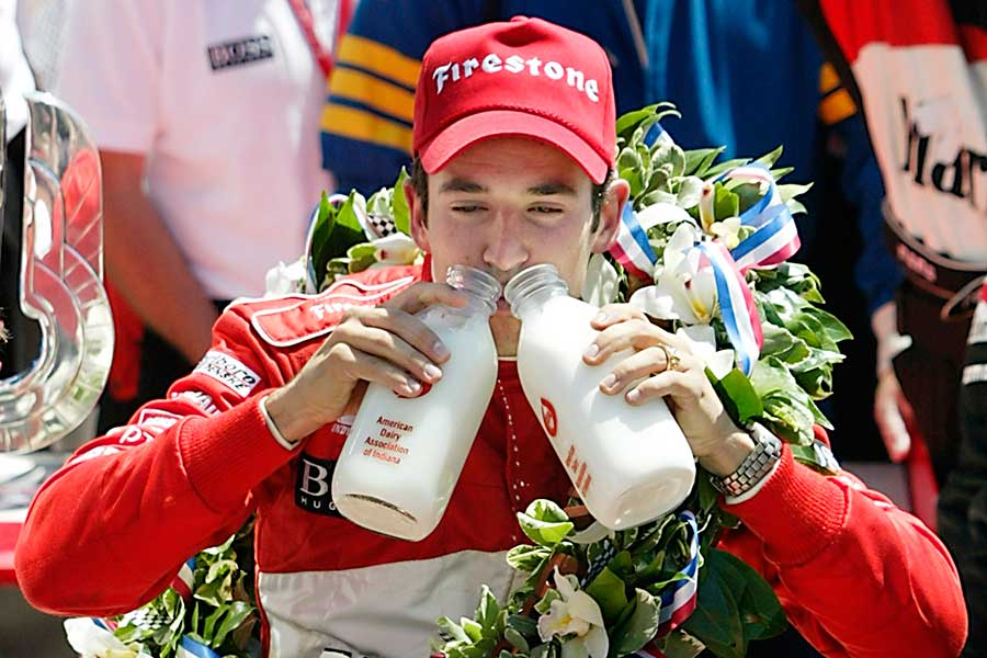 2002: Helio Castroneves celebrates back-to-back victories at the Indianapolis 500