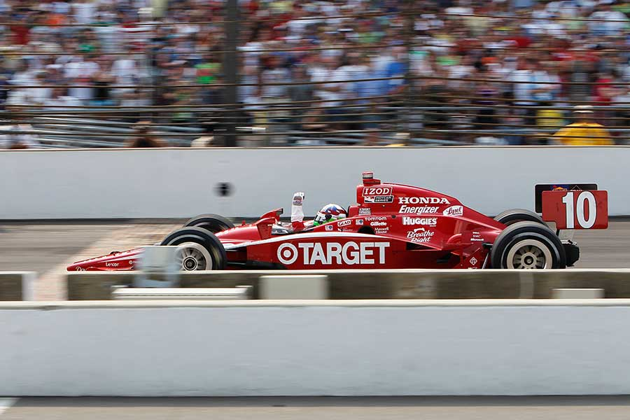 2010: Dario Franchitti crosses the line as the Indy 500 saw a British 1-2, with Dan Wheldon finishing second