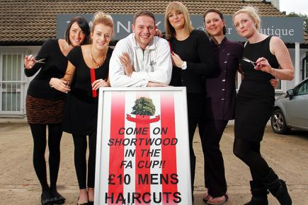 A cut above: Goalkeeper Tom King's wife Amy (both pictured centre) is offering discounted haircuts for Shortwood fans at her local salon. Picture: Carl Hewlett/TWM