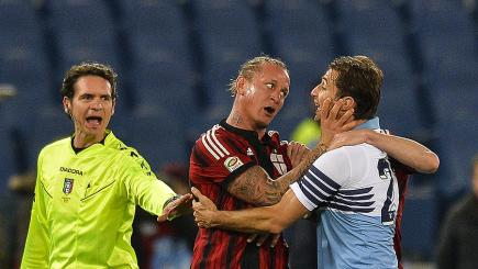 AC Milan star Philippe Mexes gets to grips with Lazio's Lorik Cana
