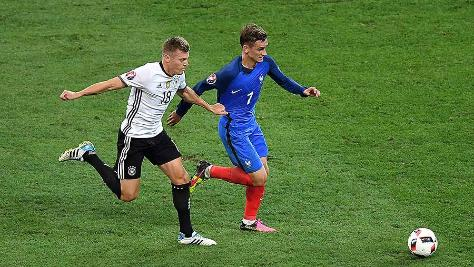Antoine Griezmann and Toni Kroos vie for the ball in the France v Germany Euro 2016 semi-final
