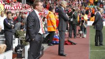 Brendan Rodgers, who has been sacked by Liverpool, stands with Arsenal manager Arsene Wenger during a league match at Anfield last year