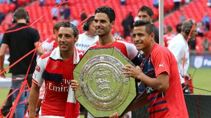 Arsenal's Santi Cazorla, Mikel Arteta and Alexis Sanchez (left to right) celebrate victory over the Manchester City in the Community Shield match at Wembley Stadium, London.