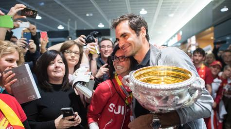 Australian Open champion Federer and 'Norman' receive warm Swiss welcome