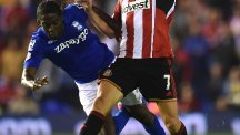 Birmingham City's Clayton Donaldson (left) and Sunderland's Sebastian Larsson (right) battle for the ball during the Capital One Cup Second Round match at St Andrews, Birmingham.
