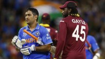 Mahendra Singh Dhoni, left, guided India to a four-wicket win (AP)