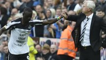 Newcastle's Papiss Cisse, left, celebrates his goal with manager Alan Pardew, right