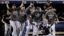 Carlos Santana celebrates after sealing the Cleveland Indians' place in the World Series (AP)
