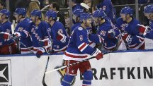 Dan Girardi celebrates scoring the New York Rangers' winning goal (AP)