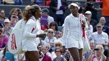 Serena Williams, left, and sister Venus will meet for the 26th time in Monday's last-16 clash at SW19