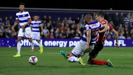 Paddy McNair (right) scores Sunderland's first goal at QPR