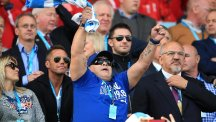 Diego Maradona shows his support for Argentina in their World Cup victory over Tonga