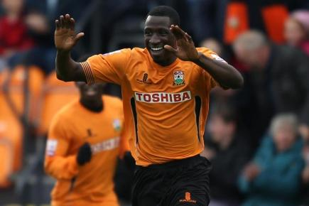 Barnet's Anthony Acheampong celebrates scoring the opening goal of the game