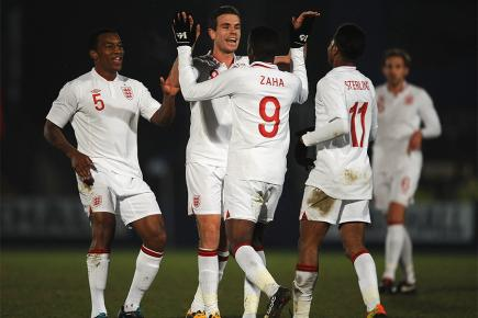 England Under-21s celebrate scoring against Romania in friendly