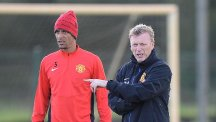 Rio Ferdinand, left, has been critical of former Manchester United manager David Moyes, right, in his autobiography