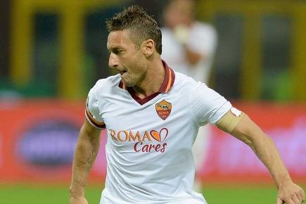 Francesco Totti is set to feature for Roma against AC Milan