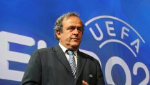 UEFA president Michel Platini will be asked to exempt away fans from stadium closures imposed for racism