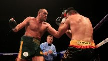 Tyson Fury, left, saw off Christian Hammer in London