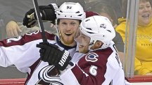 Gabriel Landeskog, left, fired an overtime winner to condemn Pittsburgh to a first defeat of the season (AP)