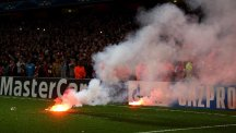 Galatasaray fans threw flares onto the pitch at the Emirates