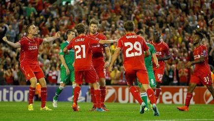 Liverpool celebrate with captain Steven Gerrard after he scored the winning goal from the spot