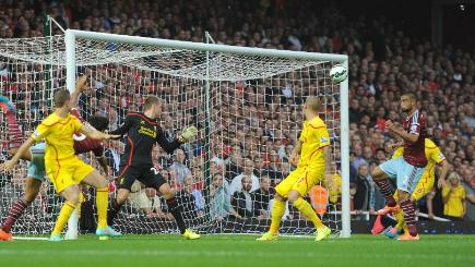 Winston Reid, far right, scores West Ham's first goal against Liverpool