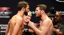 Heated words: Luke Rockhold and Michael Bisping exchange pleasantries at the weigh-in