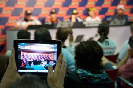 Person holding iPad at MotoGP news conference