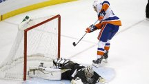 Kyle Okposo scores past Marc-Andre Fleury to secure victory for the New York Islanders (AP)