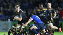 Joe Launchbury powers his way through the Leinster defence in Wasps' European Rugby Champions Cup opener