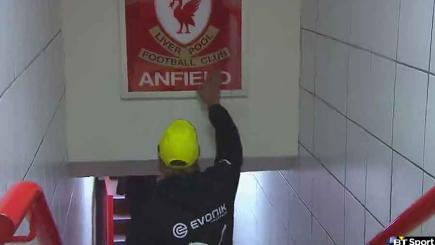 Jurgen Klopp touches the famous 'This Is Anfield' sign