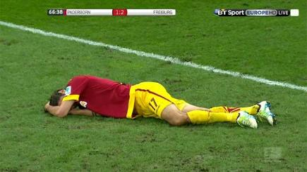 Paderborn's Niklas Hoheneder was knocked out by a punch clearance from Freiburg goalkeeper Alexander Schwolow.