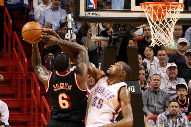 cff0ac796998 Kevin Durant (35) of Oklahoma City Thunder defends against Miami Heat s  LeBron James (