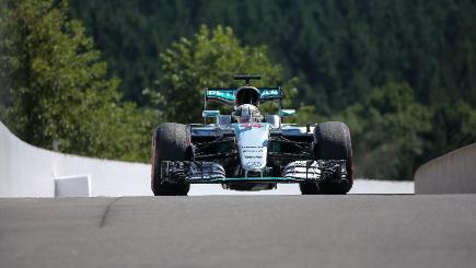 Rosberg wins in Belgium as Hamilton beats odds to podium