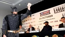Tyson Fury, pictured left, dressed as Batman in one of the build-up press conferences for his bout against Wladimir Klitschko