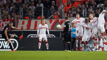 Raul Bobadilla of Augsburg (L) scores against Cologne in the Bundesliga.
