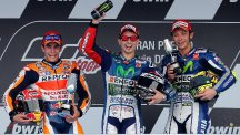 Jorge Lorenzo, centre, was victorious in his home country (AP)