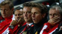 Louis Van Gaal looks on as Manchester United slump to defeat at MK Dons