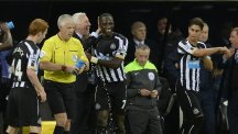 Moussa Sissoko, centre, celebrates his goal against QPR with Newcastle manager Alan Pardew
