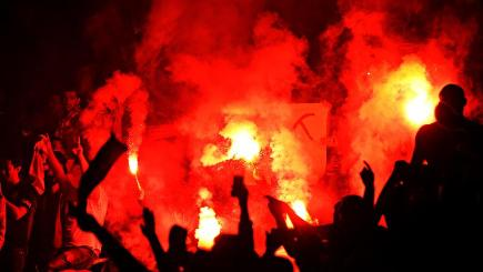 Galatasaray fans let off flares at the Emirates