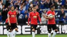 Manchester United players look on after Leicester goal