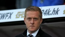 Garry Monk has completed his first signing for Leeds