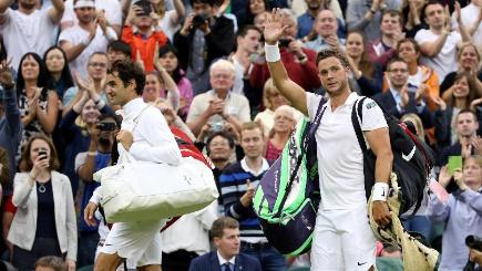 Marcus Willis, right, slipped to a 6-0 6-3 6-4 defeat against Roger Federer