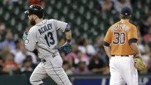Dustin Ackley, left, hit two homers for the Mariners (AP)