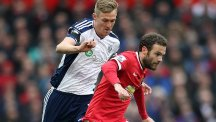Mata (right) is chased by West Brom's Darren Fletcher during Saturday's match at Old Trafford