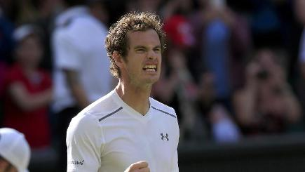 Andy Murray celebrates beating Ivo Karlovic on Centre Court