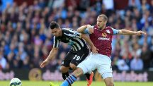 Newcastle United's Emmanuel Riviere (left) and Aston Villa's Ron Vlaar battle for the ball during the Barclays Premier League match at Villa Park, Birmingham.