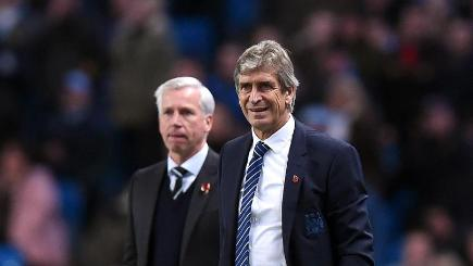 Manchester City manager Manuel Pellegrini, right, admitted concern after his side's Capital One Cup loss to Newcastle