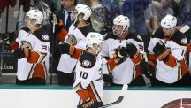 Corey Perry, centre, is the NHL's leading scorer (AP)